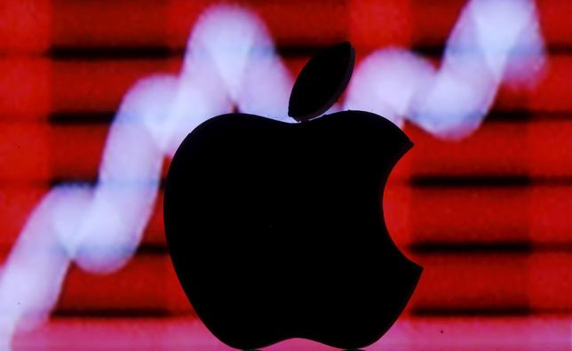 A 3D printed Apple logo is seen in front of a displayed stock graph in this illustration taken February 26, 2016. REUTERS/Dado Ruvic/Illustration