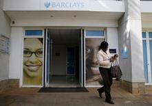 A woman walks from a banking hall within the Barclays Bank Kenya head offices in the capital Nairobi, March 1, 2016. REUTERS/Thomas Mukoya