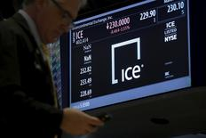A trader passes by a screen displaying the trading info for Intercontinental Exchange Inc. (ICE) on the floor of the New York Stock Exchange (NYSE) March 1, 2016. REUTERS/Brendan McDermid