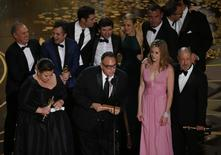 "Producer Michael Sugar accepts the Oscar for Best Picture for his film ""Spotlight"" with his fellow producers and cast at the 88th Academy Awards in Hollywood, California February 28, 2016.  REUTERS/Mario Anzuoni - RTS8H4W"