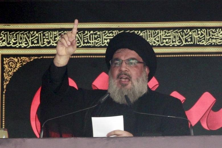 Lebanon's Hezbollah leader Sayyed Hassan Nasrallah addresses his supporters during a public appearance at a religious procession to mark Ashura in Beirut's southern suburbs October 24, 2015. REUTERS/Aziz Taher