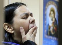 """Гюльчехра Бобокулова, няня, подозреваемая в убийстве своей подопечной, в зале суда в Москве 2 марта 2016 года. Бобокулова сказала в суде, что """"Аллах приказал"""" ей обезглавить ребенка. REUTERS/Maxim Shemetov"""