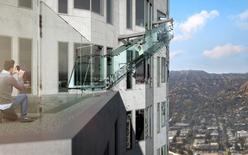 "An artist rendering of the ""Skyslide"" attraction, an outdoor glass slide positioned close to 1,000 feet above downtown Los Angeles, California, is shown in this image released by OUE Skyspace on March 2, 2016. REUTERS/OUE Skyspace/Handout via Reuters"