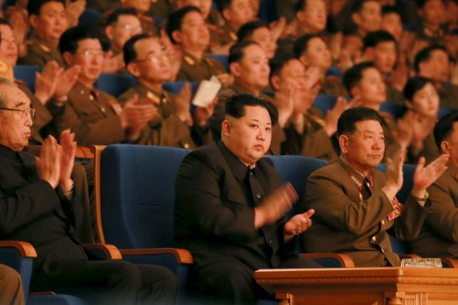 North Korean leader Kim Jong Un (C) applauds during a concert marking the 70th founding anniversary of the Korean People's Army (KPA) military band in this undated photo released by North Korea's Korean Central News Agency (KCNA) in Pyongyang February 23, 2016.   REUTERS/KCNA ATTENTION