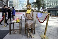 A statue of a girl that represents the sexual victims by the Japanese military is seen in front of Japanese embassy in Seoul, South Korea, December 28, 2015.   REUTERS/Ahn Eun-na/News1