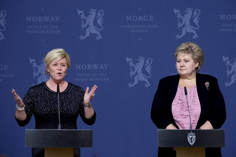 Norway's Finance Minister Siv Jensen speaks to the media next to Prime Minister Erna Solberg (R) after a meeting with the central bank governor and others to discuss Norway's economic situation after the deep plunge in the oil price, in Oslo January 25, 2016.  REUTERS/Haakon Mosvold Larsen/NTB Scanpix