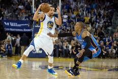 Mar 3, 2016; Oakland, CA, USA; Golden State Warriors guard Stephen Curry (30) controls the ball against Oklahoma City Thunder guard Randy Foye (6) during the third quarter at Oracle Arena.  Mandatory Credit: Kelley L Cox-USA TODAY Sports