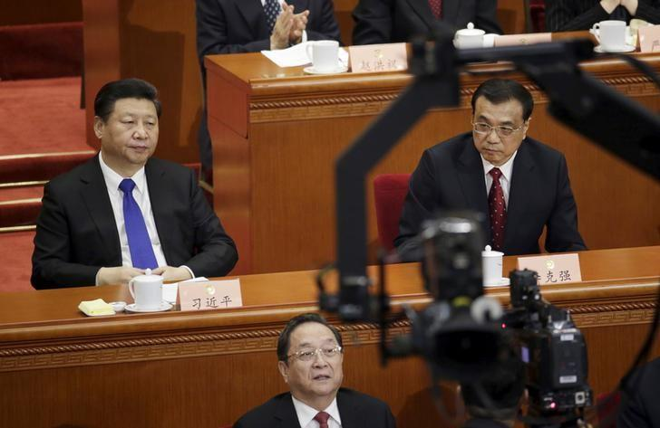 China's President Xi Jinping (L), Premier Li Keqiang (R) and Yu Zhengsheng, chairman of the National Committee of the Chinese People's Political Consultative Conference (CPPCC), attend the opening session of the CPPCC at the Great Hall of the People in Beijing, China, March 3, 2016. REUTERS/Jason Lee