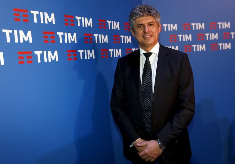 Telecom Italia CEO Marco Patuano poses in front of the new logo of its TIM brand in Rome, Italy, January 13, 2016. REUTERS/Remo Casilli