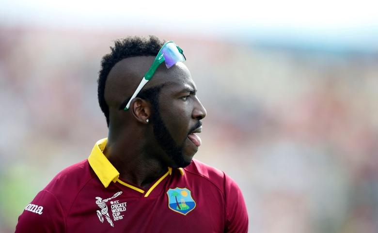 West Indies bowler Andre Russell surveys the outfield during their Cricket World Cup match against Pakistan in Christchurch, February 21, 2015.    REUTERS/Nigel Marple