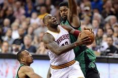 Mar 5, 2016; Cleveland, OH, USA; Cleveland Cavaliers forward LeBron James (23) drives to the basket between Boston Celtics guard Avery Bradley (0) and forward Amir Johnson (90) during the second quarter at Quicken Loans Arena. Mandatory Credit: Ken Blaze-USA TODAY Sports