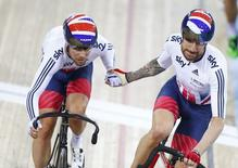 UCI World Track Cycling Championships - London, Britain - 6/3/2016 - Sir Bradley Wiggins (R) of Britain hands over to Mark Cavendish during the madison. REUTERS/Andrew Winning