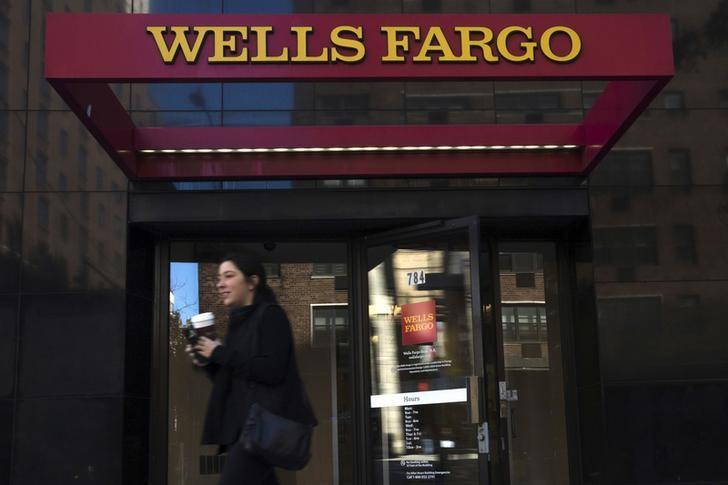 A woman exits a Wells Fargo ATM in the Manhattan borough of New York, October 10, 2015.  REUTERS/Eduardo Munoz