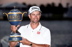 Mar 6, 2016; Miami, FL, USA; Adam Scott celebrates with  the Cadillac Championship trophy the Gene Sarazen Cup following the final round at TPC Blue Monster at Trump National Doral. Mandatory Credit: John David Mercer-USA TODAY Sports