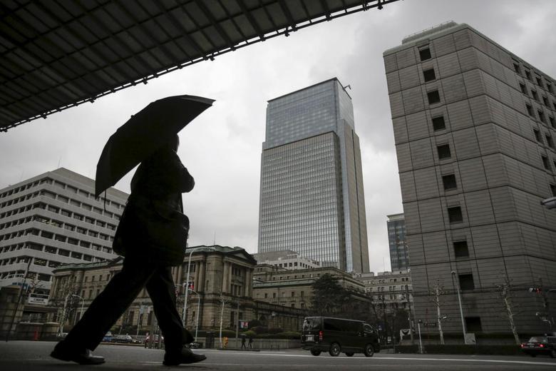 A businessman walks near the Bank of Japan (BOJ) headquarters in Tokyo, Japan,  February 15, 2016. REUTERS/Thomas Peter