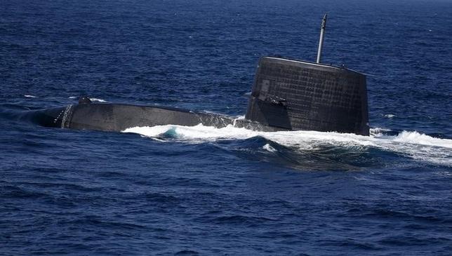 The Uzushio submarine of the Japan Maritime Self-Defense Force (JMSDF) bursts to the surface during a fleet review at Sagami Bay, off Yokosuka, south of Tokyo October 18, 2015. REUTERS/Toru Hanai