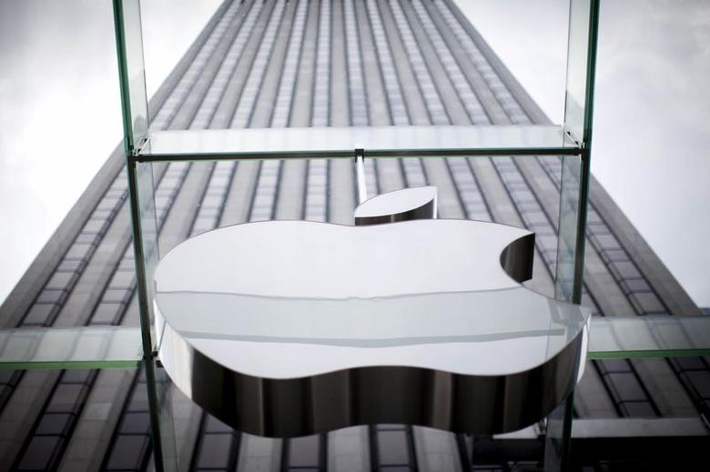 An Apple logo hangs above the entrance to the Apple store on 5th Avenue in New York City, in this file photo taken July 21, 2015. REUTERS/Mike Segar/Files