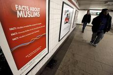 "A poster promoting the new documentary film ""The Muslims Are Coming is seen inside the City Hall subway station in the Manhattan borough of New York City, March 7, 2016. Humorous ads for a documentary film that aims to promote understanding and tolerance of Muslims went up in New York subways on Monday after the movie's production company won a legal battle with the city's transit authority. REUTERS/Mike Segar        EDITORIAL USE ONLY. NO RESALES. NO ARCHIVE"