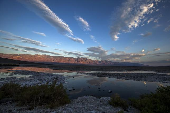 Badwater, in Death Valley National Park, the lowest elevation in the Western Hemisphere at 280 feet below sea level, is seen at sunrise in California in this July 15, 2013 file photo. REUTERS/Lucy Nicholson/Files