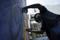 Thai graffiti artist Asin Acid works on his graffiti wall in Bangkok, Thailand, March 7, 2016. REUTERS/Athit Perawongmetha