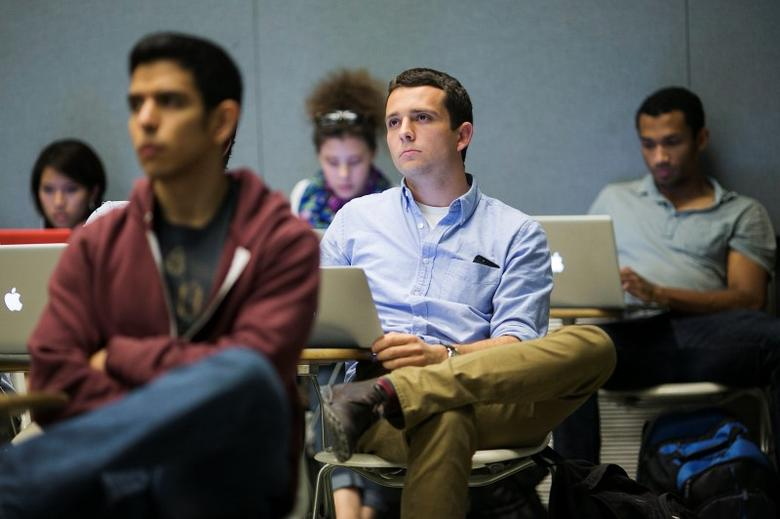 Stanford University students listen while classmates make a presentation to a group of visiting venture capitalists during their Technology Entrepreneurship class in Stanford, California March 11, 2014. REUTERS/Stephen Lam
