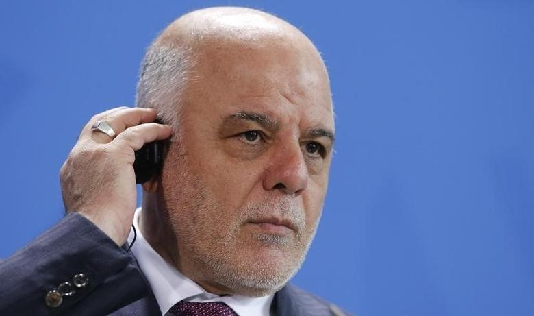 Iraq's Prime Minister Haidar al-Abadi listens to a translation during a news conference at the Chancellery in Berlin, Germany, February 11, 2016.       REUTERS/Fabrizio Bensch
