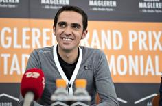 Alberto Contador holds a news conference, before participating in a street race, in Aalborg, Denmark August 18, 2015.  REUTERS/Henning Bagger/Scanpix Denmark