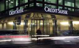 The Credit Suisse logo is seen at the headquarters in downtown Milan, Italy, March 9, 2016. Credit Suisse Group is under investigation in Italy in connection with a case looking into allegations that the bank helped wealthy clients transfer undeclared funds offshore, Italian judicial sources said on Wednesday.  REUTERS/Stefano Rellandini