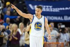 Mar 3, 2016; Oakland, CA, USA; Golden State Warriors guard Stephen Curry (30) points to the fans after the win against the Oklahoma City Thunder at Oracle Arena. The Golden State Warriors defeated the Oklahoma City Thunder 121-106. Mandatory Credit: Kelley L Cox-USA TODAY Sports