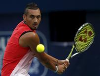 Nick Kyrgios of Australia returns the ball to Stanislas Wawrinka of Switzerland during their semi final match at the ATP Dubai Duty Free Tennis Championships, February 26, 2016. REUTERS/Ahmed Jadallah