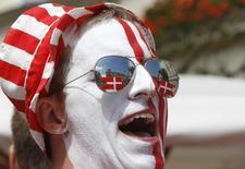Болельщик сборной Дании по футболу во Львове. 13 июня 2012 года. Дания стала самой счастливой страной в мире, обогнав Швейцарию, согласно докладу, опубликованному в среду. REUTERS/Gleb Garanich