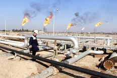 Нефтяное месторождение Nahr Bin Umar в Ираке.  Цены на нефть растут после подтверждения предстоящей встречи производителей для переговоров о замораживании добычи. REUTERS/Essam Al-Sudani