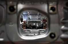 Audi A3 light weight construction chassis are seen at the production line of the German car manufacturer's plant in the Bavarian city of Ingolstadt April 11, 2013.  REUTERS/Michaela Rehle