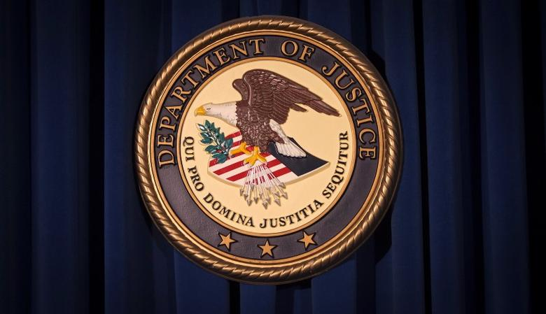 The Department of Justice (DOJ) logo is pictured on a wall after a news conference to discuss alleged fraud by Russian Diplomats in New York December 5, 2013.     REUTERS/Carlo Allegri (UNITED STATES - Tags: CRIME LAW) - RTX1657T