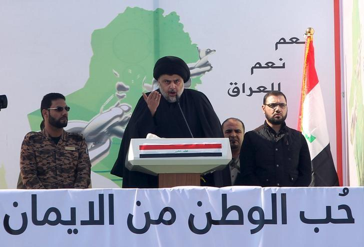 Prominent Iraqi Shi'ite cleric Moqtada al-Sadr (C) speaks during a protest against corruption at Tahrir Square in Baghdad February 26, 2016. REUTERS/Alaa Al-Marjani/Files