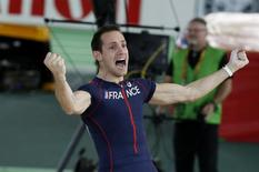 Renaud Lavillenie of France celebrates after clearing the bar at 5.90 meters during the men's pole vault event at the IAAF World Indoor Athletics Championships in Portland, Oregon March 17, 2016.  REUTERS/Lucy Nicholson