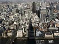 The shadow of the Shard is cast across the financial district of London, Britain, as seen from The View from The Shard, in this January 9, 2013 file photo.  REUTERS/Luke Macgregor/Files