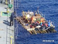 A raft of the Kon-Tiki 2 international raft expedition, is seen during a Chilean Navy rescue operation on a merchant ship, in Pacific Ocean waters off Puerto Montt, southern Chile in this Chilean Navy handout photo taken March 17, 2016. REUTERS/Chilean Navy/Handout via Reuters