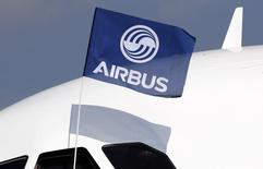 A flight test engineer holds an Airbus Group flag after the first flight of the Airbus A320neo (New Engine Option) in Colomiers near Toulouse, southwestern France, September 25, 2014. REUTERS/Regis Duvignau/Files