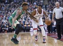 Mar 18, 2016; Toronto, Ontario, CAN; Toronto Raptors guard Kyle Lowry (7) dribbles past Boston Celtics guard Marcus Smart (36) in the second quarter at Air Canada Centre. Mandatory Credit: Peter Llewellyn-USA TODAY Sports