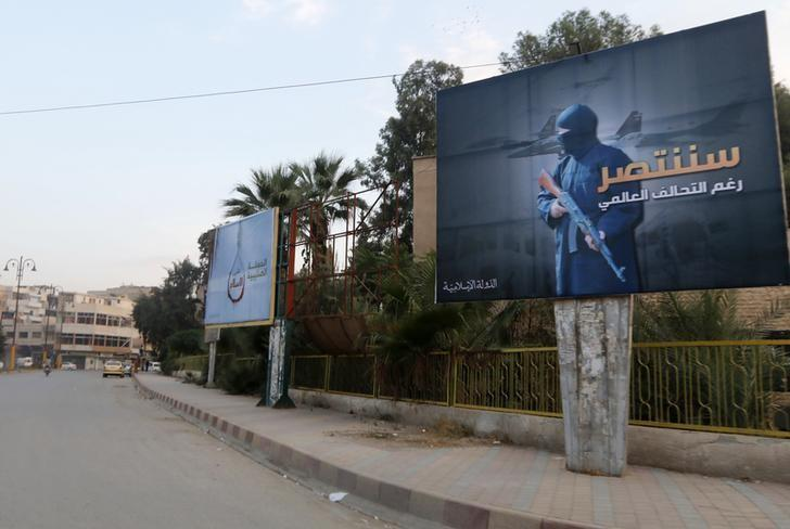 File photo of Islamic State billboards seen along a street in Raqqa, eastern Syria, which is controlled by the Islamic State, October 29, 2014. REUTERS/Nour Fourat
