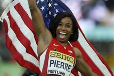 Barbara Pierre of the U.S. celebrates after winning the gold medal in the women's 60 meters during the IAAF World Indoor Athletics Championships in Portland, Oregon March 19, 2016. REUTERS/Lucy Nicholson