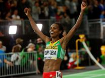 Genzebe Dibaba of Ethiopia celebrates after winning the women's 3000 meters final during the IAAF World Indoor Athletics Championships in Portland, Oregon March 20, 2016.   REUTERS/Mike Blake