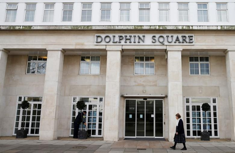 A pedestrian walks past Dolphin Square in London March 5, 2015. REUTERS/Suzanne Plunkett