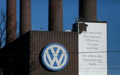 A Volkswagen company logo adorns the VW factory in Wolfsburg, Germany November 20, 2015. Text reads :  'We need transparancy, openess, energy and courage.'  REUTERS/Ina Fassbender