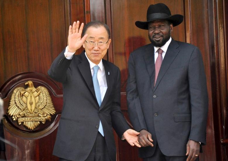United Nations Secretary-General Ban Ki-moon waves next to South Sudan's President Salva Kiir in the capital Juba February 25, 2016. REUTERS/Jok Solomon