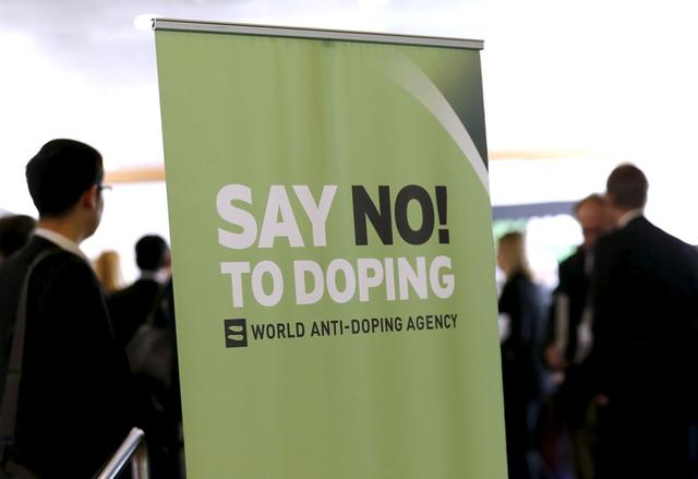 Participants talk before the start of the World Anti-Doping Agency (WADA) Symposium for Anti-Doping Organizations in Lausanne, Switzerland, in this March 24, 2015 file photo. REUTERS/Denis Balibouse/Files