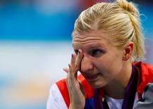 Britain's Rebecca Adlington wipes away tears after receiving her bronze medal on the podium during the women's 800m freestyle victory ceremony at the London 2012 Olympic Games at the Aquatics Centre August 3, 2012.   REUTERS/Michael Dalder