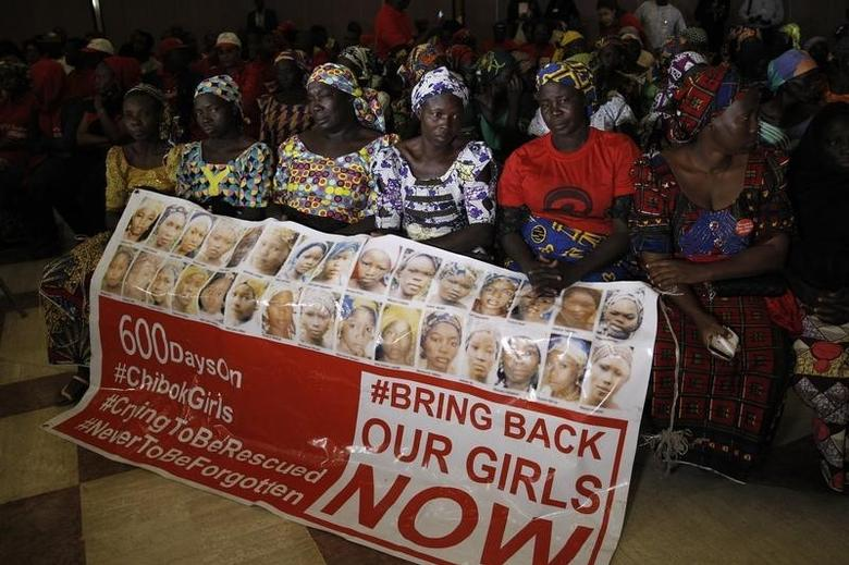 Parents of the Chibok girls hold a ''Bring Back Our Girls'' banner during their meeting with Nigeria's President Muhammadu Buhari at the presidential villa in Abuja, Nigeria, January 14, 2016. REUTERS/Afolabi Sotunde