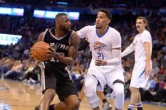 Mar 26, 2016; Oklahoma City, OK, USA; San Antonio Spurs guard Jonathon Simmons (17) drives to the basket agains tOklahoma City Thunder guard Andre Roberson (21) during the fourth quarter at Chesapeake Energy Arena. Mandatory Credit: Mark D. Smith-USA TODAY Sports